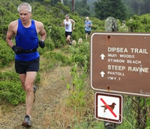 Man running on a rugged trail at the Dipsea Race