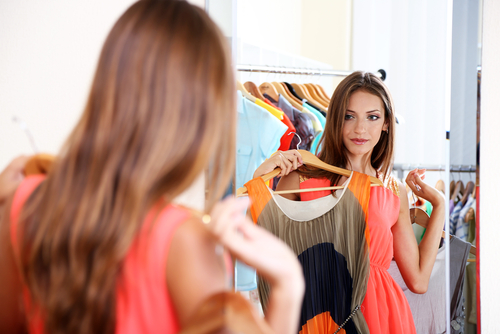 woman-looking-at-clothing-in-the-mirror