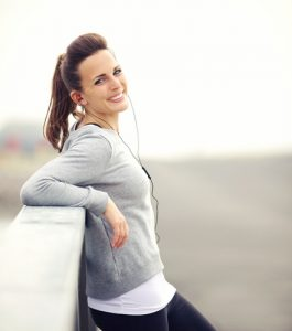 Smiling woman having her break after running