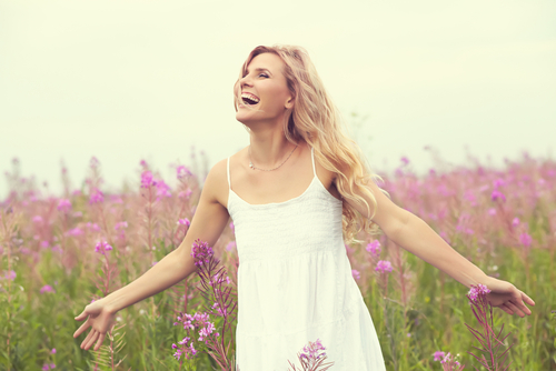 outdoor portrait of a beautiful middle aged blonde woman. attractive sexy girl in a field with flowers-img-blog